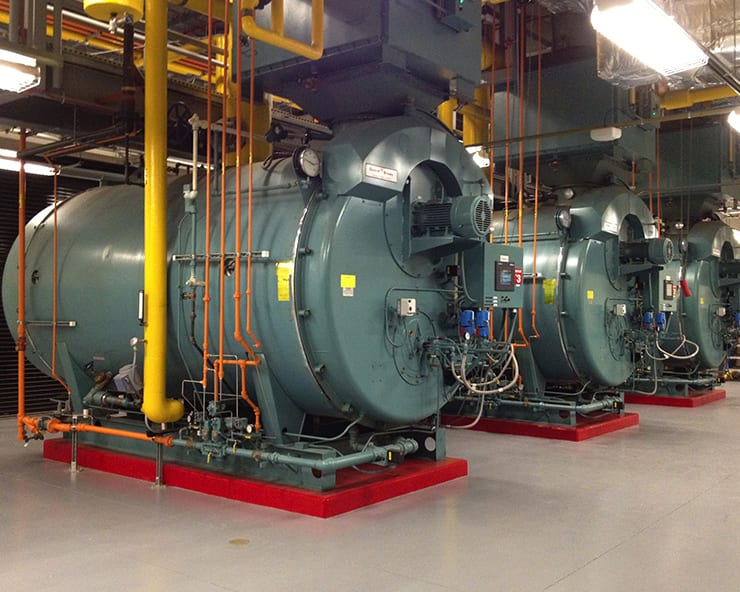Pharmaceutical Steam Boiler Cleaning Case Study. Image of the boiler room at a pharmaceutical company.