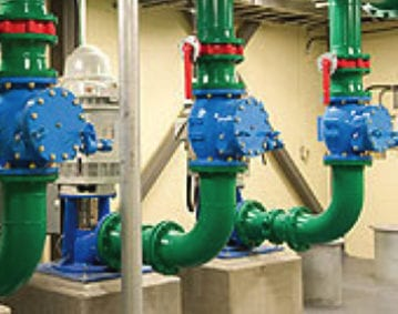Holding Tank Transfer Pump Cleaning Case Study. Image of several holding tank transfer pumps in a utility room.